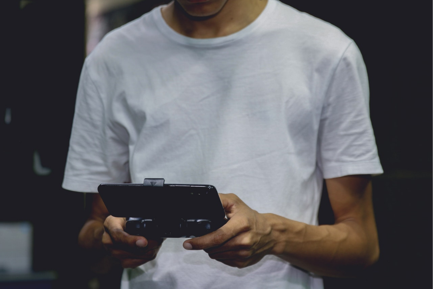 man using gaming device